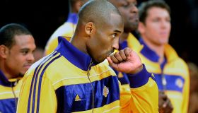 Lakers Kobe Bryant kisses his championship ring during a ceremony at the Staples Center Tuesday.