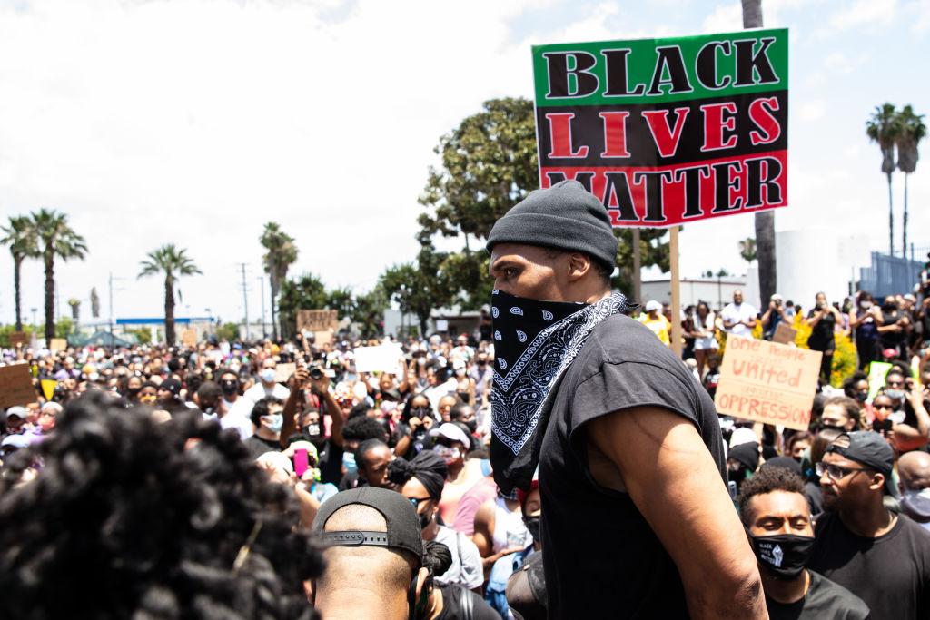 The Compton Cowboys participate in a Compton Peace Walk