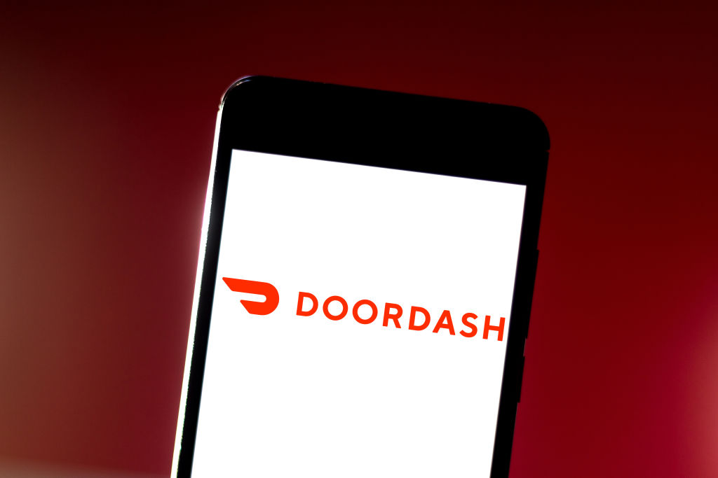 In this photo illustration the DoorDash logo is seen...