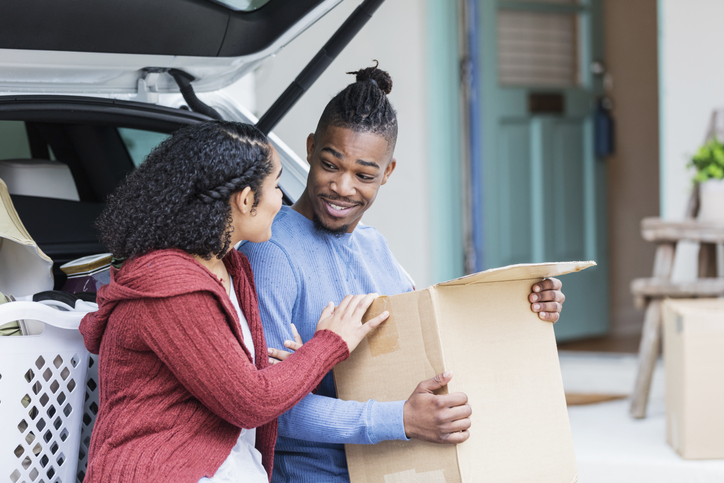 Young African-American couple moving