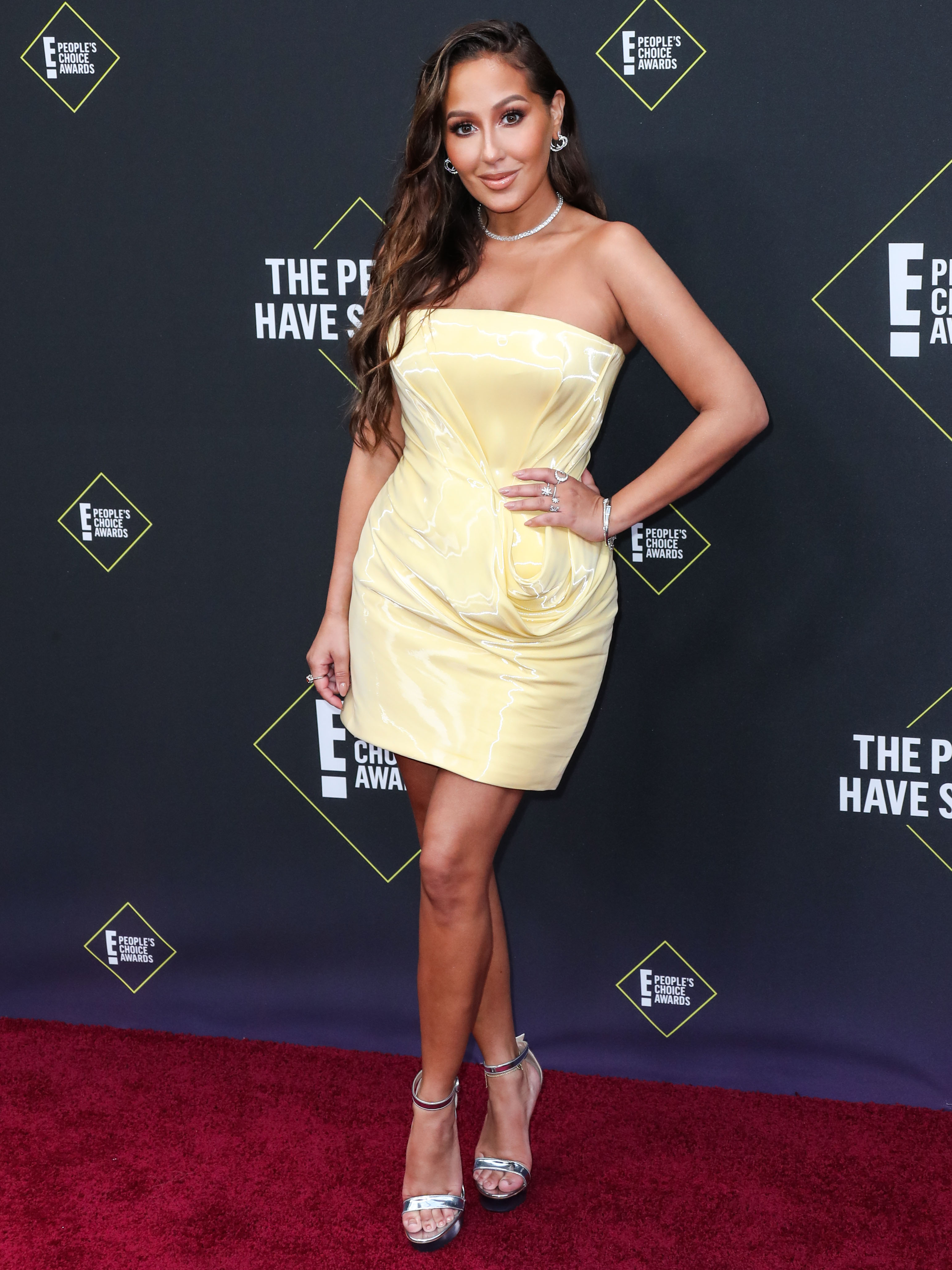 Adrienne Bailon Houghton arrives at the 2019 E! People's Choice Awards held at Barker Hangar on November 10, 2019 in Santa Monica, Los Angeles, California, United States.