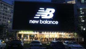 A huge screen shows the logo New balance an American sports...