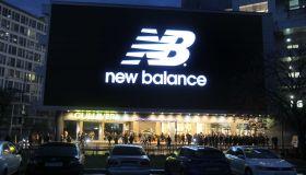 A huge screen shows the logo New balance an American sports...