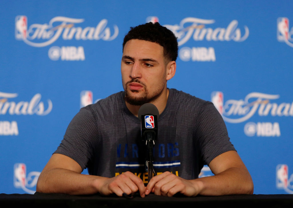 Golden State Warriors' Klay Thompson (11) listens to a question during media day the day before Game 1 of the NBA Finals at Oracle Arena in Oakland, Calif., on Wednesday, June 1, 2016. (Nhat V. Meyer/Bay Area News Group)