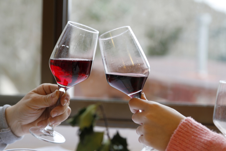 Couple toasting with two wine glasses