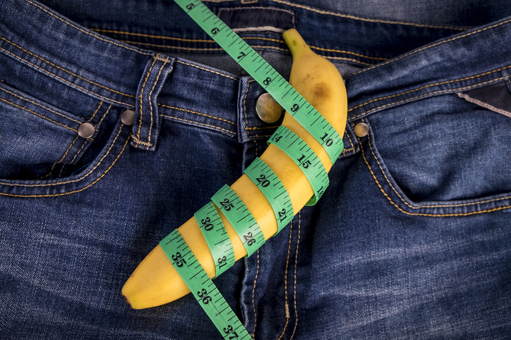 Directly Above Shot Of Banana And Tape Measure On Jeans