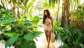 Slim woman in cotton suit at tropical nature in summer.