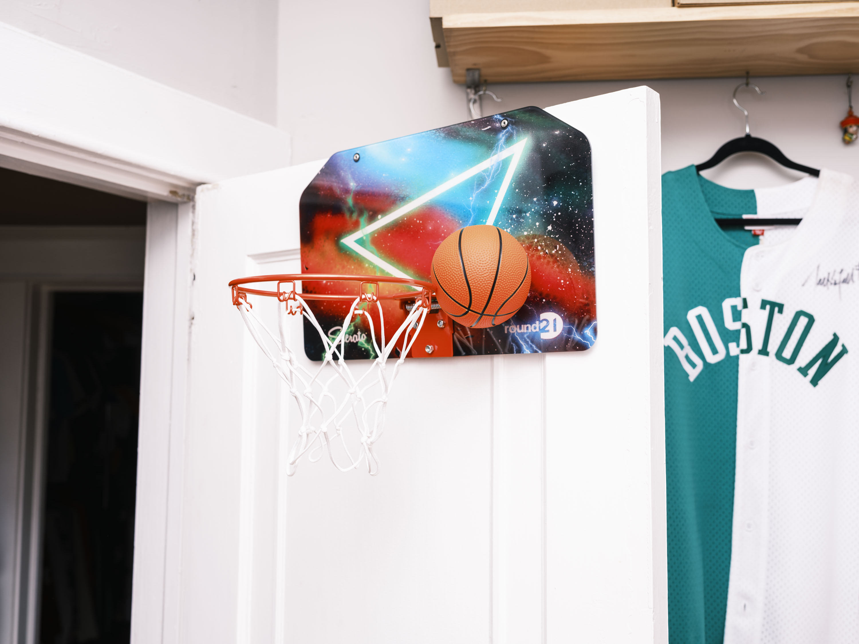 """This backboard comes alive through Sierato's classic """"galaxy"""" design. The backboard includes custom work for round21 to symbolize the youthful energy and power that fuels our desire to constantly create and express who we are."""