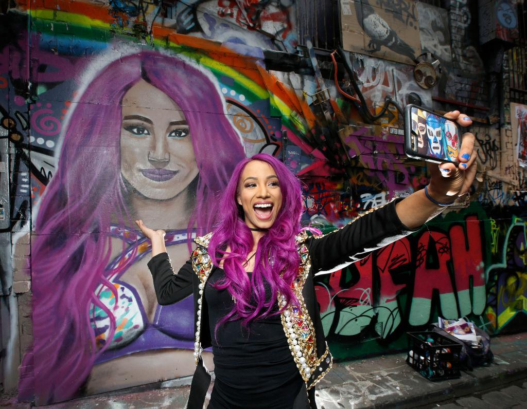 WWE Wrestler Sasha Banks Takes Selfie In Front Of Mural