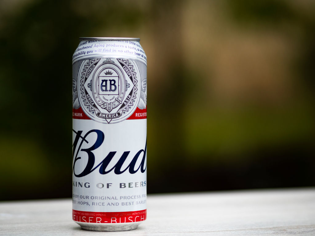 In this photo illustration a Bud light beer can seen...