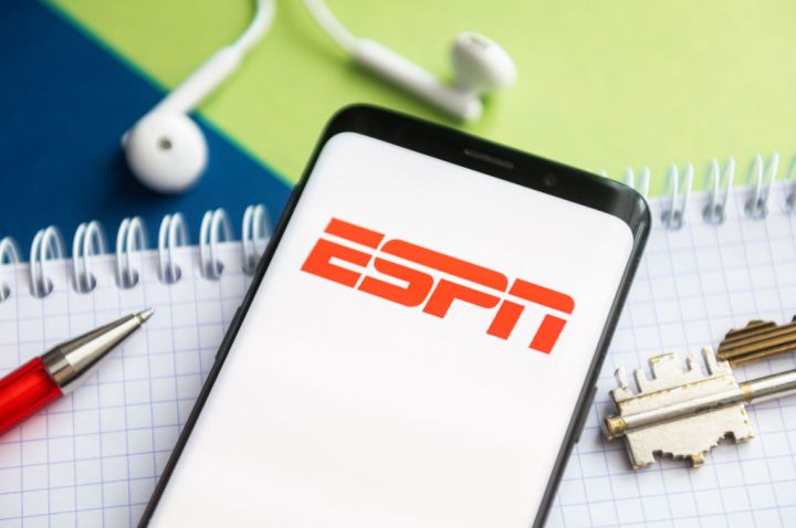 In this photo illustration, a ESPN logo seen displayed on a...