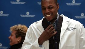(020107 Boston, MA) Tufts-New England Medical Center dedicates their minimally invasive surgery center to Celtic Paul Pierce at a ceremony at NEMC on Thursday, February 01, 2007. Celtics Paul Pierce tries on a lab coat and stethoscope as NEMC pres