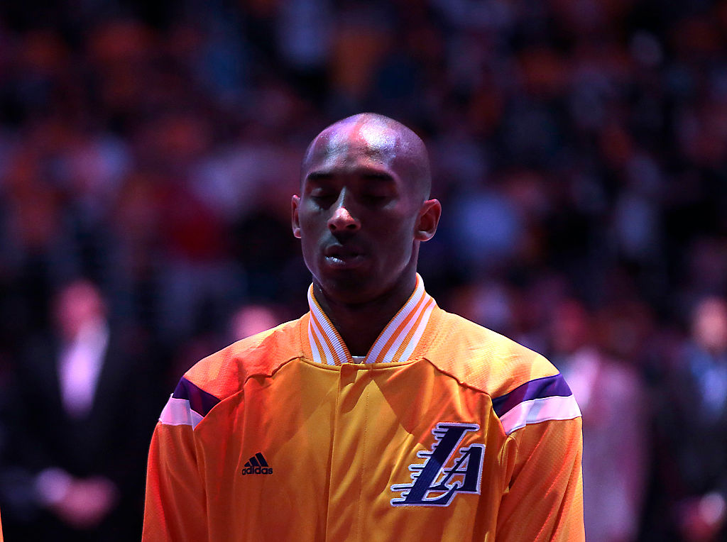 LOS ANGELES, CA, TUESDAY, OCTOBER 28, 2014 - Lakers guard Kobe Bryant listens as the National Anthem