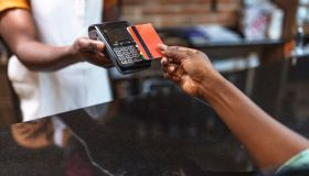 Cropped shot of an unrecognizable woman paying for her purchase by card