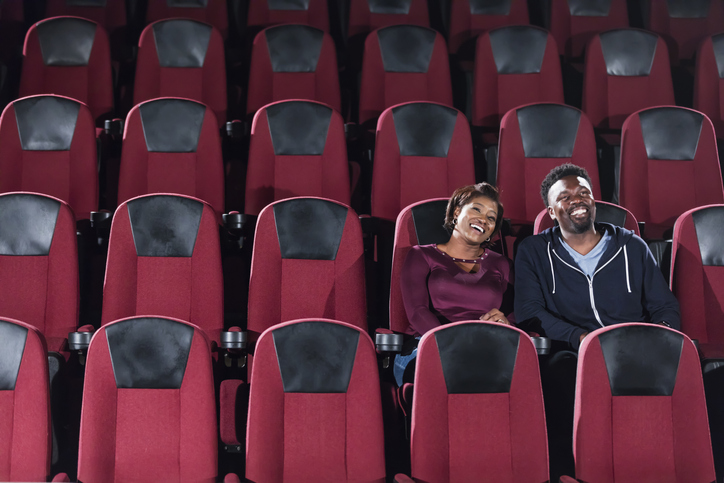 African-American couple alone in movie theater