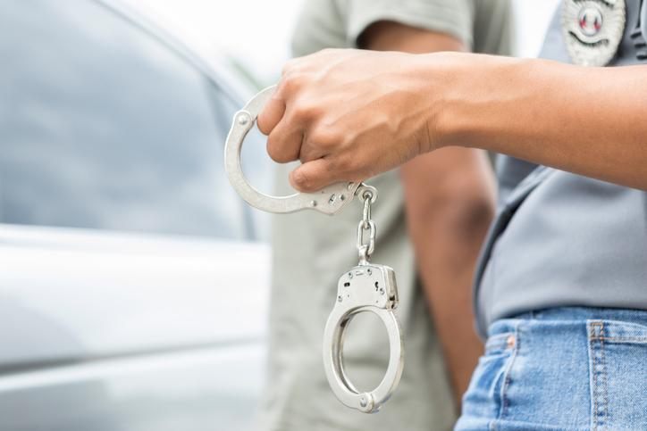 Police officer arrests driver for traffic violation
