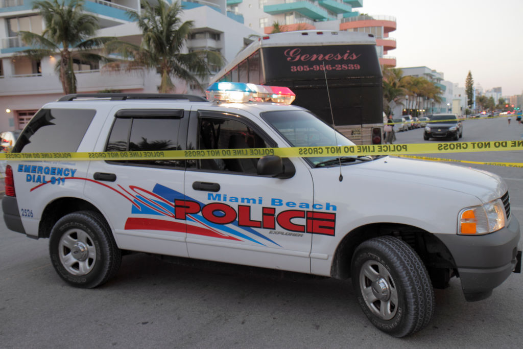 A police car at a collision site on Ocean Drive.