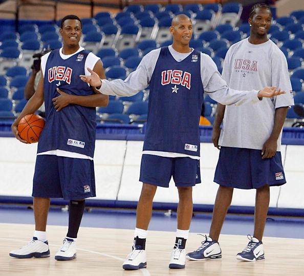 Reggie Miller (C) of the USA Basketball team stand