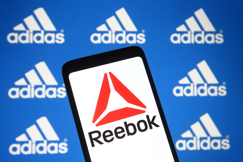 In this photo illustration the Reebok logo seen on a...