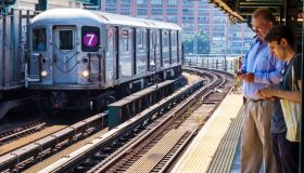New York, Queens, Court Square subway platform, 7 Line train with commuters