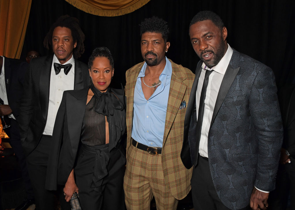 'The Harder They Fall' stars Regina King, Deon Cole, and Idris Elba pictured with producer Jay-Z at the 2021 BFI London Film Festival.